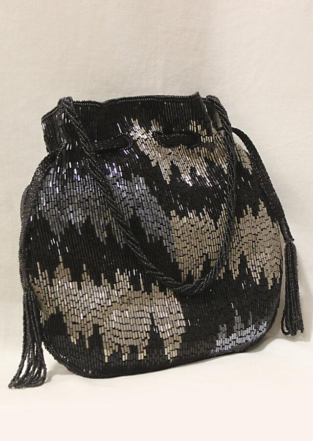 Black Potli Bag In Raw Silk Hand Embroidered With Cut Dana Work In Abstract Design Online - Kalki Fashion