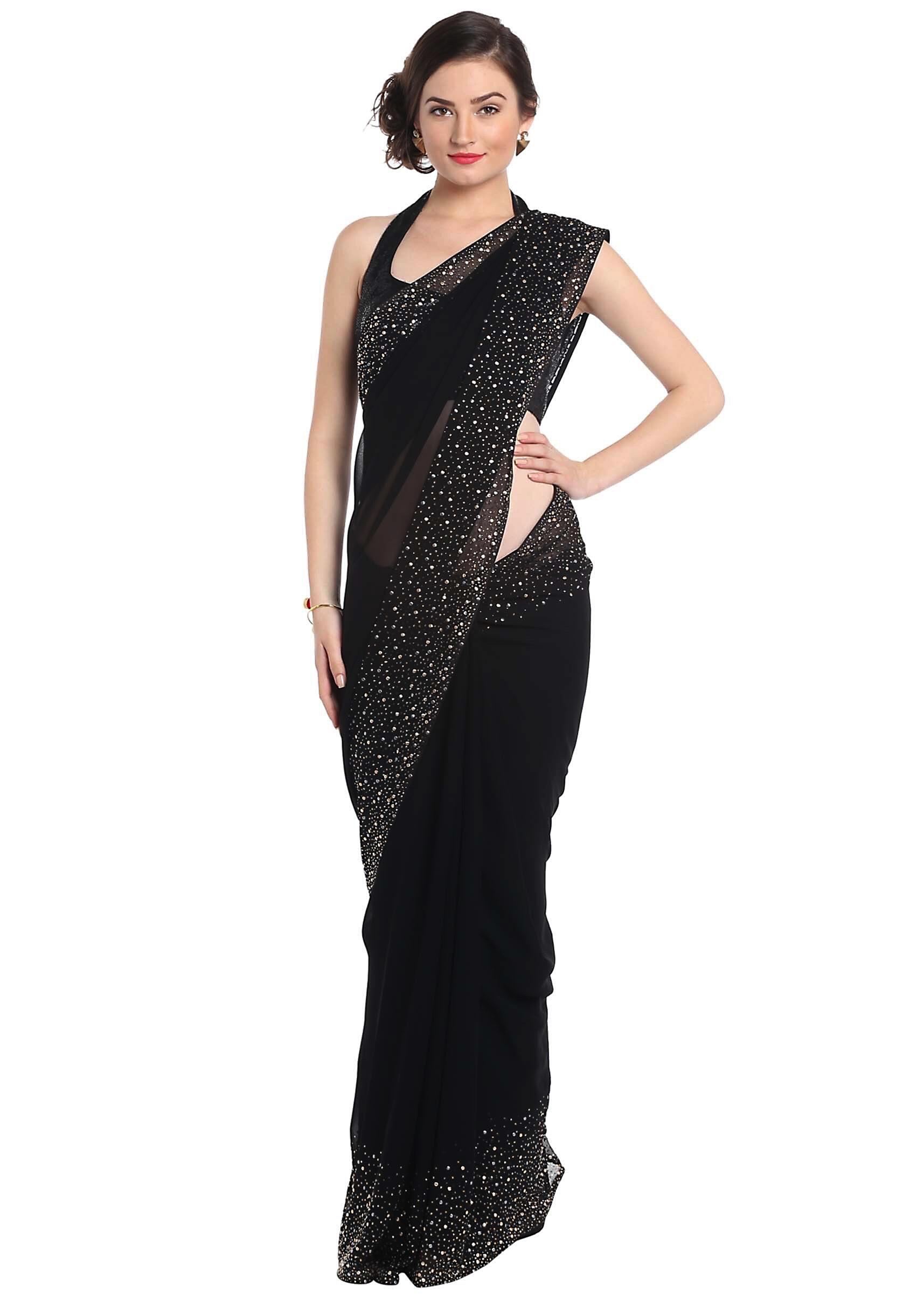 9e0408569af4f Black saree adorn in gold and silver kundan embroidery only on Kalki