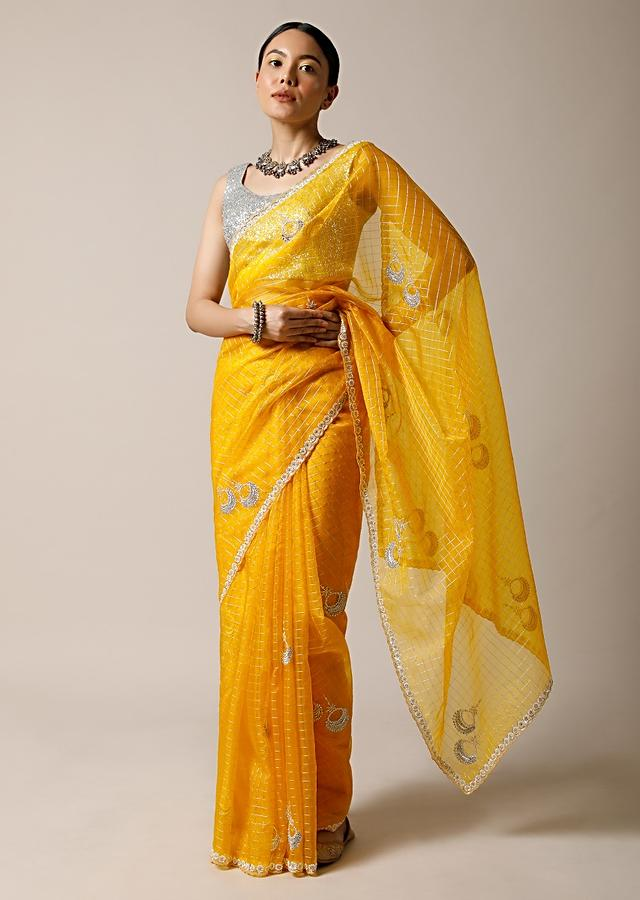Amber Yellow Saree In Organza With Woven Checks And Stone Embellished Buttis Along With Unstitched Blouse Online - Kalki Fashion