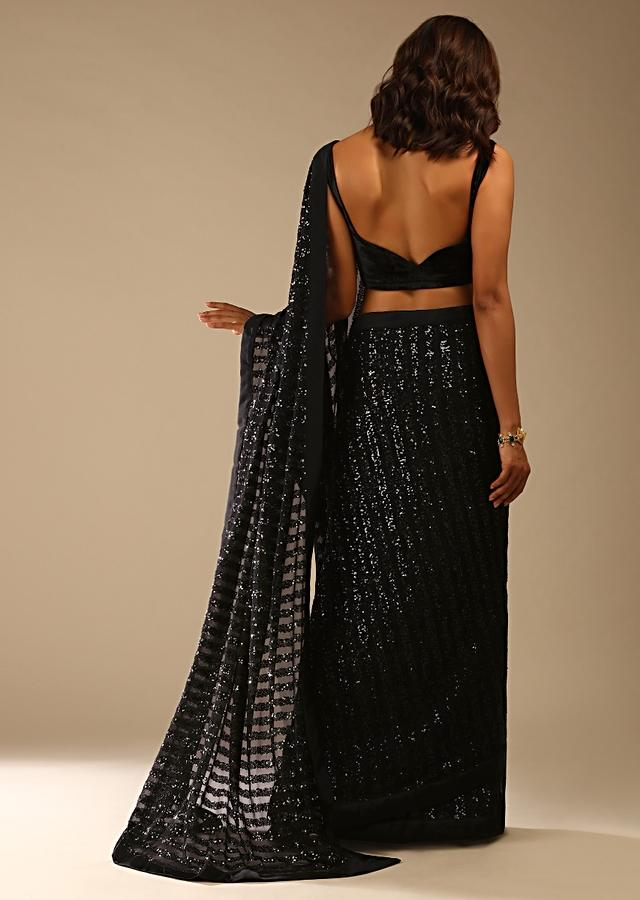 Black Ready Pleated Saree In Striped Sequins Fabric And A Sleeveless Velvet Blouse With A Front Cut Out Online - Kalki Fashion