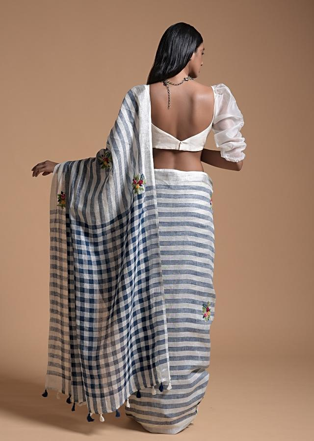 Blue And White Saree In Linen With Woven Stripes And Bud Embroidered Floral Buttis Online - Kalki Fashion