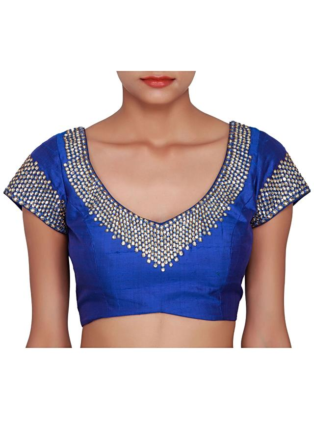 Blue blouse featured in raw silk, embellished in stone  only on Kalki