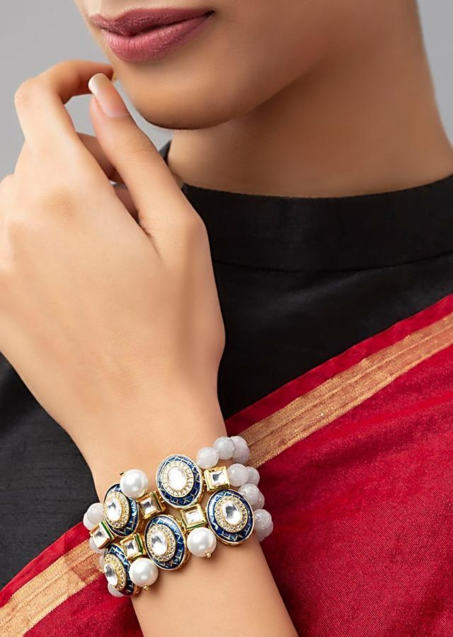 Blue Bracelet With Agate Bead Strings, Swarovski Stones, Shell Pearls And Meenakari Detailing On Round Motifs Online - Joules By Radhika