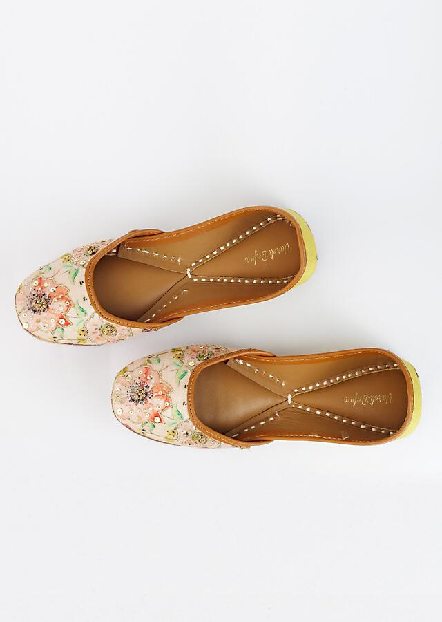 Blush Pink Juttis With Floral Print That Is Highlighted Using French Knot, Zari And Sequins Embroidery By Vareli Bafna