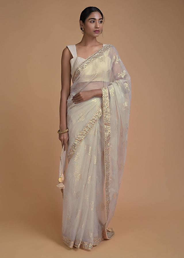 Bone White Saree In Organza With Foil Printed Floral Buttis All Over Online - Kalki Fashion