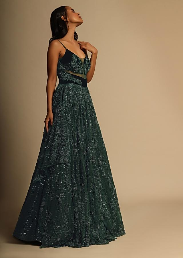 Bottle Green Gown In Net With Sheer Cutouts In The Front And Heavily Embroidered Using Beads And Sequins Online - Kalki Fashion