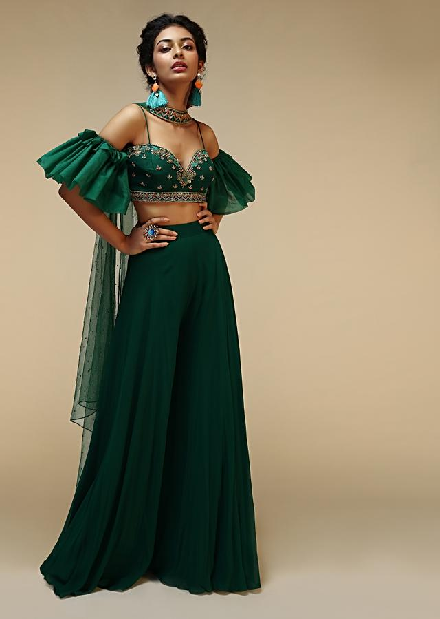Bottle Green Palazzo Suit With A Cold Shoulder Crop Top Featuring Short Bell Sleeves And Multi Colored Hand Embroidery Online - Kalki Fashion