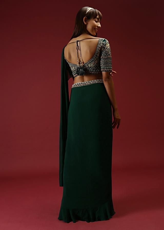 Bottle Green Ready Pleated Ruffle Saree With A Multi Colored Hand Embroidered Blouse And Plain Belt Online - Kalki Fashion