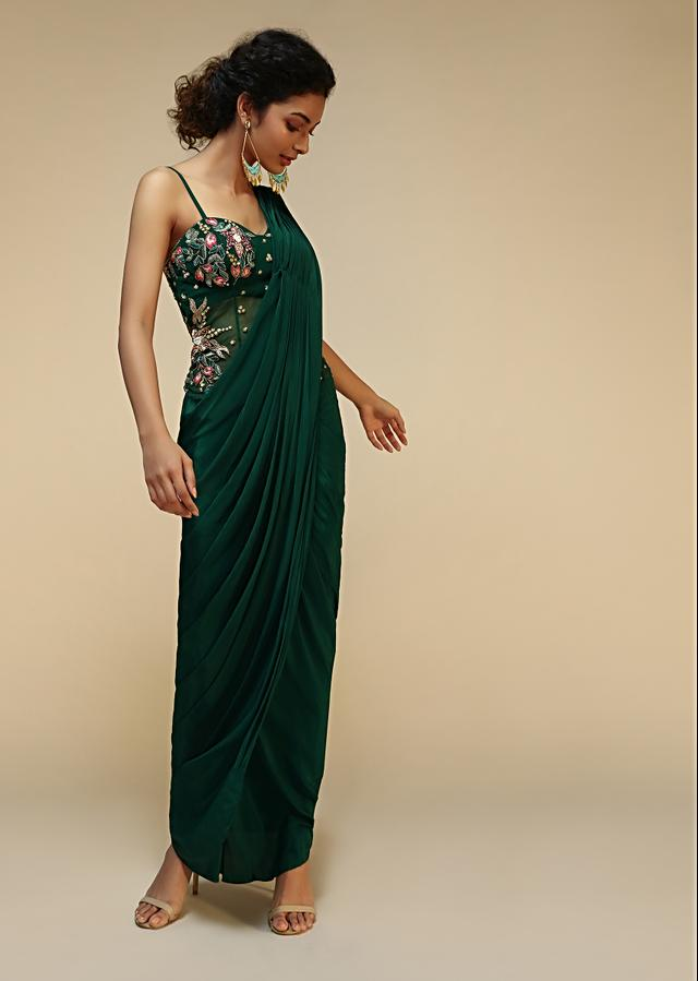 Bottle Green Saree Gown With A Crepe Cowl Drape And Sheer Embroidered Net Bodice With Colorful Resham Flowers Online - Kalki Fashion
