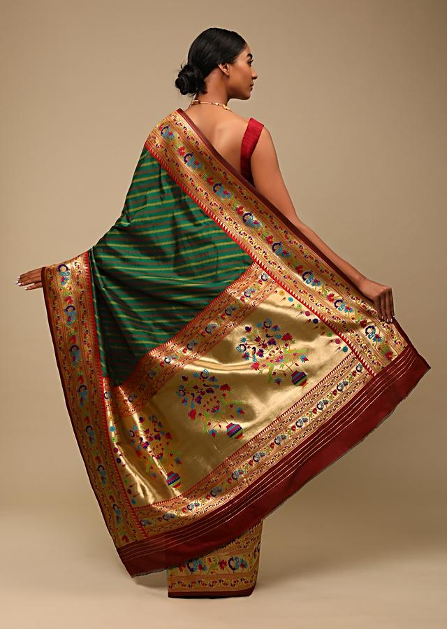 Bottle Green Saree In Pure Handloom Silk With Woven Multi Colored Peacock Motifs On The Border, Diagonal Stripes And Unstitched Blouse Online - Kalki Fashion