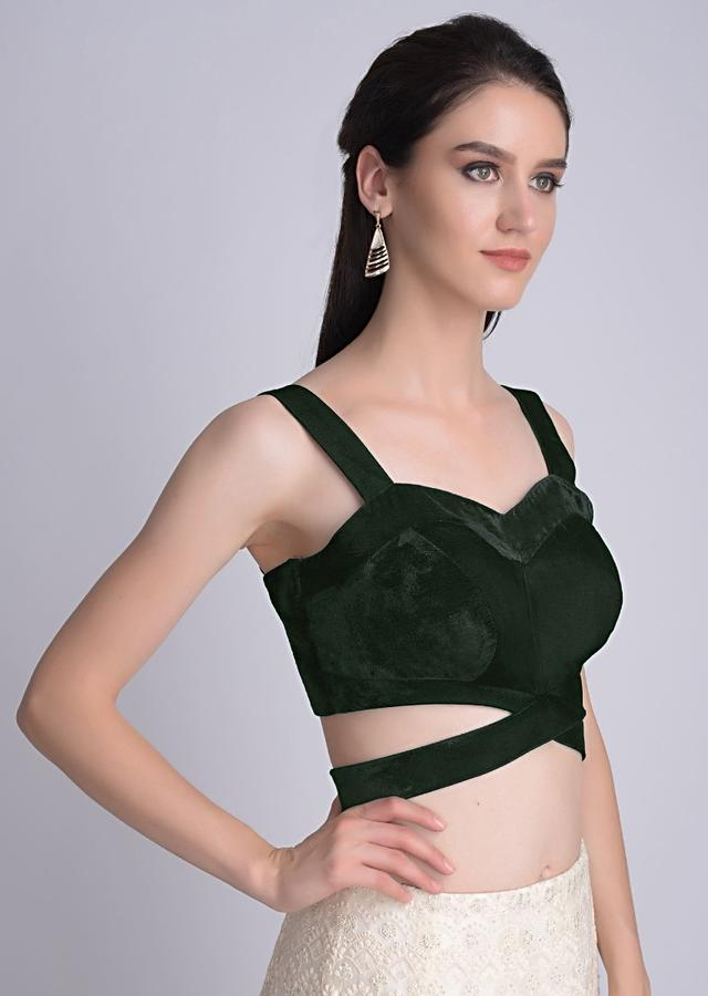 Bottle Green Sleeveless Blouse In Velvet With Cut Out At The Waist Online - Kalki Fashion