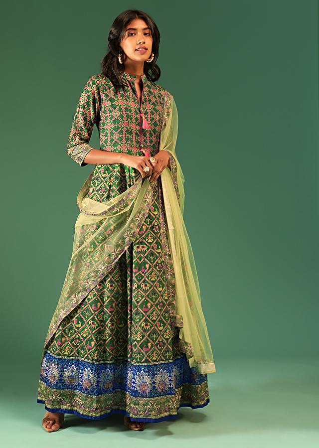 Bottle Green Anarkali Suit In Raw Silk With Patola Print And Kundan Detailing Along With A Yellow Net Dupatta Online - Kalki Fashion