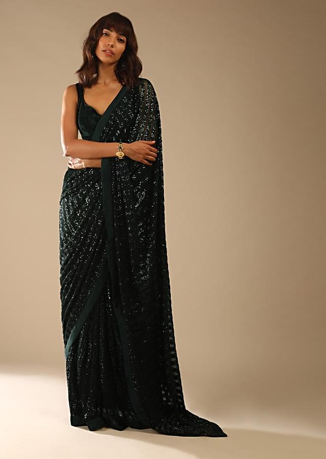 Bottle Green Ready Pleated Saree In Striped Sequins Fabric And A Sleeveless Velvet Blouse With A Front Cut Out Online - Kalki Fashion