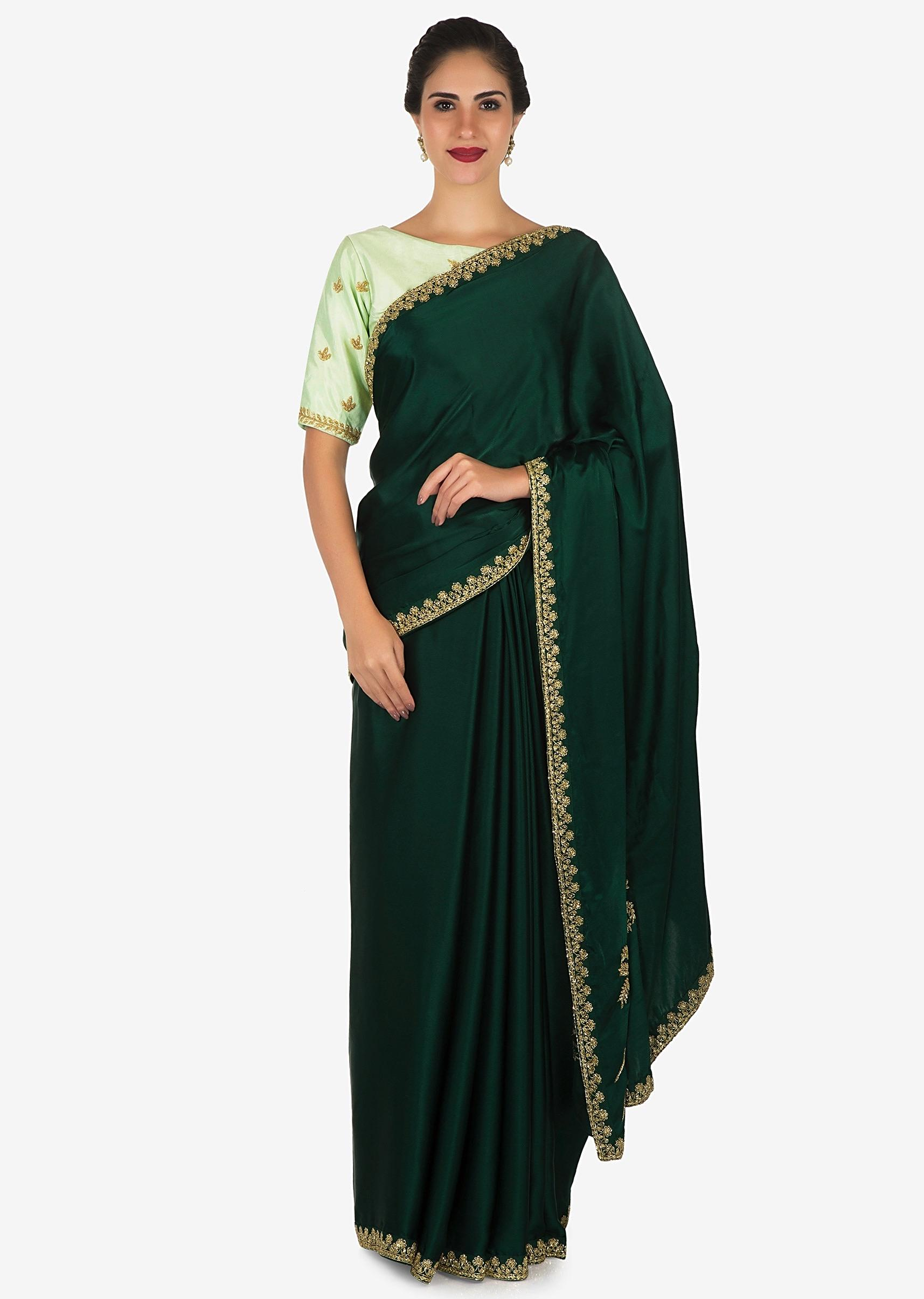 00769eba2e Bottle green saree with mustard blouse carved in heavy cut dana embroidery  work only on KalkiMore Detail