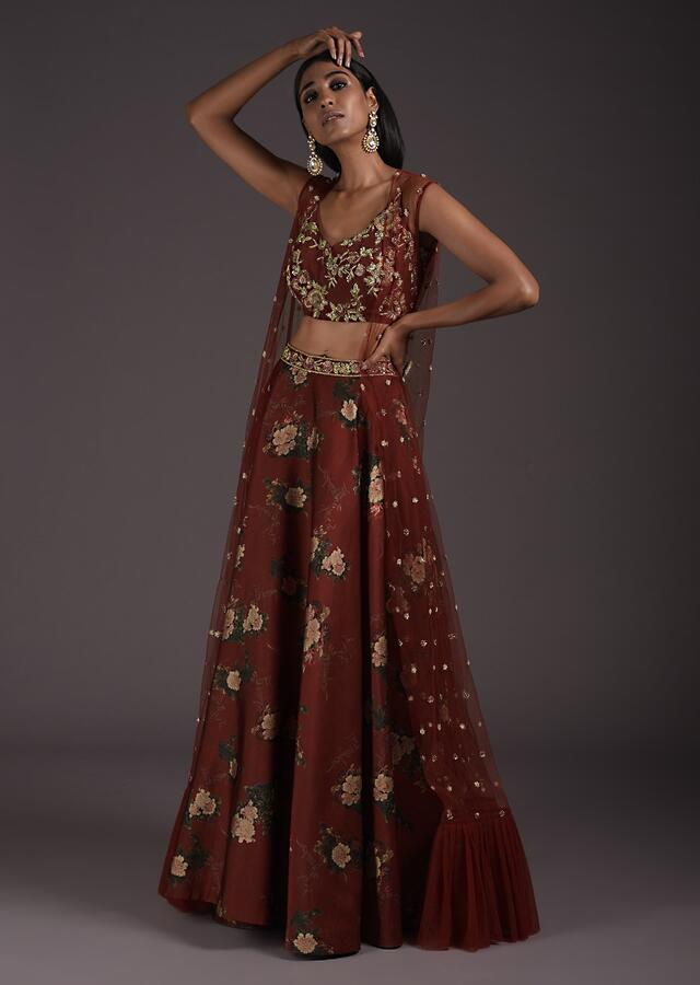 Brick Red Floral Printed Lehenga And Embroidered Crop Top Set With Long Jacket Having A Frill On The Hem Online - Kalki Fashion