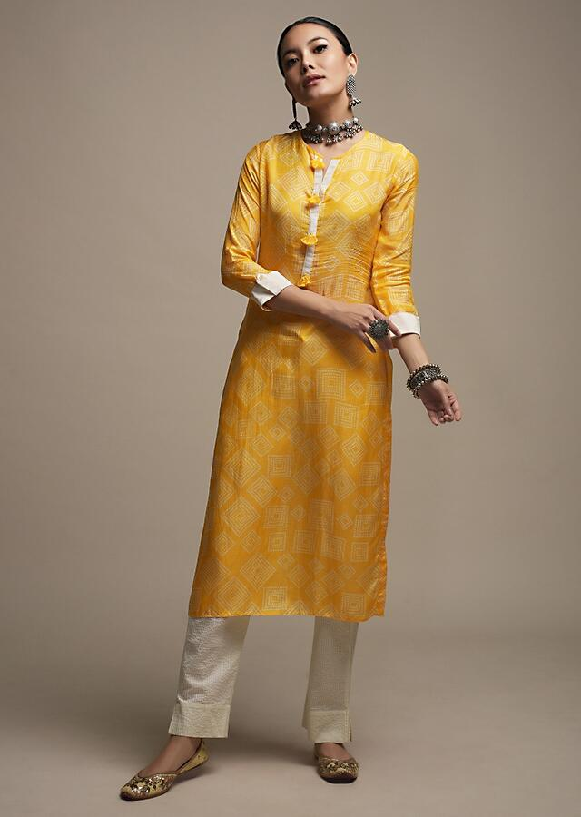 Bright Yellow Straight Cut Kurti In Cotton With Bandhani Print In Geometric Design And Tassels On The Placket Online - Kalki Fashion
