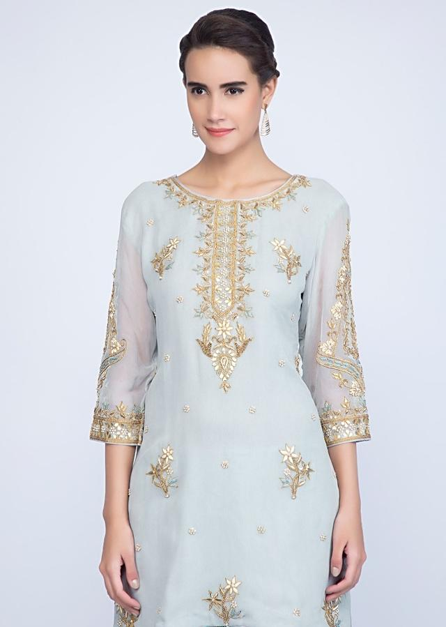 Brittany Blue Suit In Embroidered Georgette With Weaved Sharara And Chiffon Dupatta Online - Kalki Fashion
