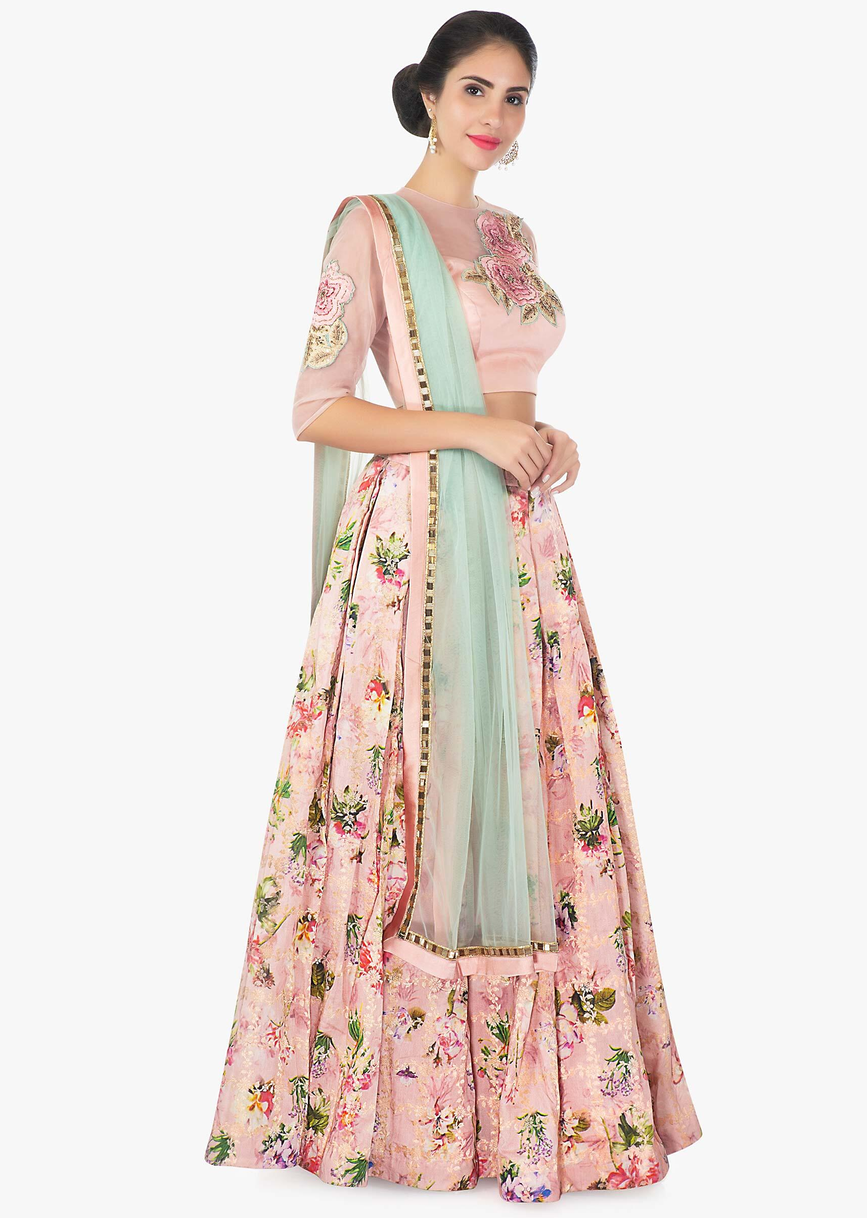 b5f10d8b5bb8 Brocade mix floral print peach skirt with a Milano satin net blouse only on  Kalki