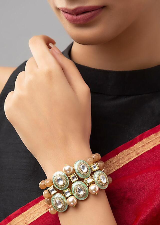 Brown Bracelet With Agate Bead Strings, Swarovski Stones, Shell Pearls And Meenakari Detailing On Round Motifs Online - Joules By Radhika