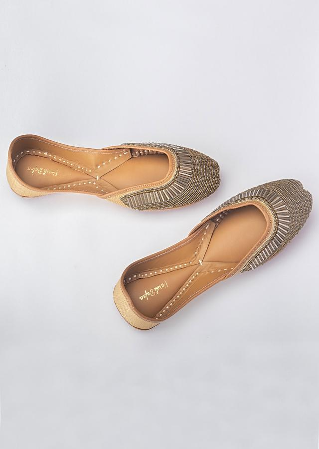 Brown Juttis In Banarasi With Silver And Antique Gold Beads And Salli By Vareli Bafna