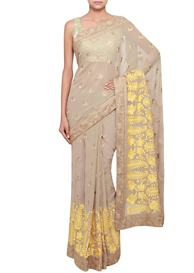 Frosted almond saree in georgette embellished in yellow resham and gold zari only on Kalki