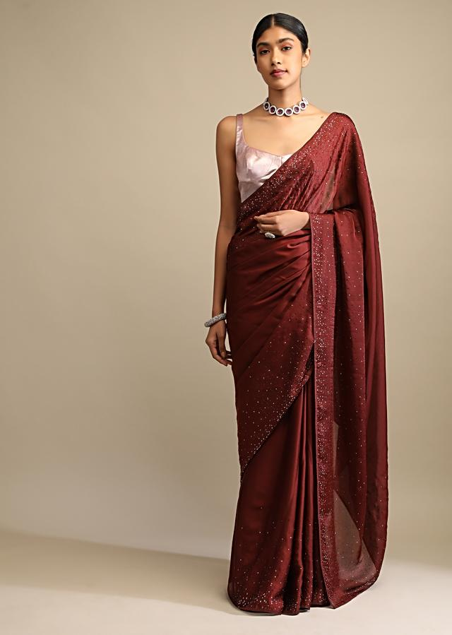 Brown Saree In Satin Embellished With Scattered Red And Silver Kundan Along The Border And Unstitched Blouse Online - Kalki Fashion