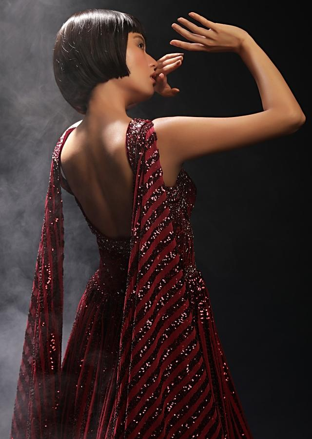 Burgundy Gown In Sequins Embellished Net With Attached Cape And Cut Dana Accented Front Cut Bodice Online - Kalki Fashion