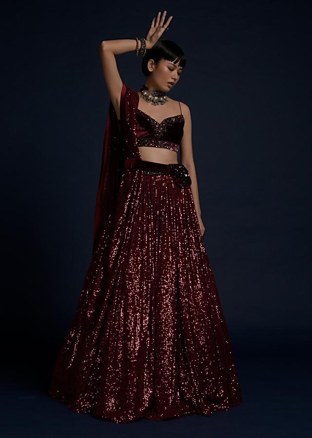 Burgundy Lehenga In Sequins Fabric With A Velvet Crop Top And Matching Belt Bag Online - Kalki Fashion