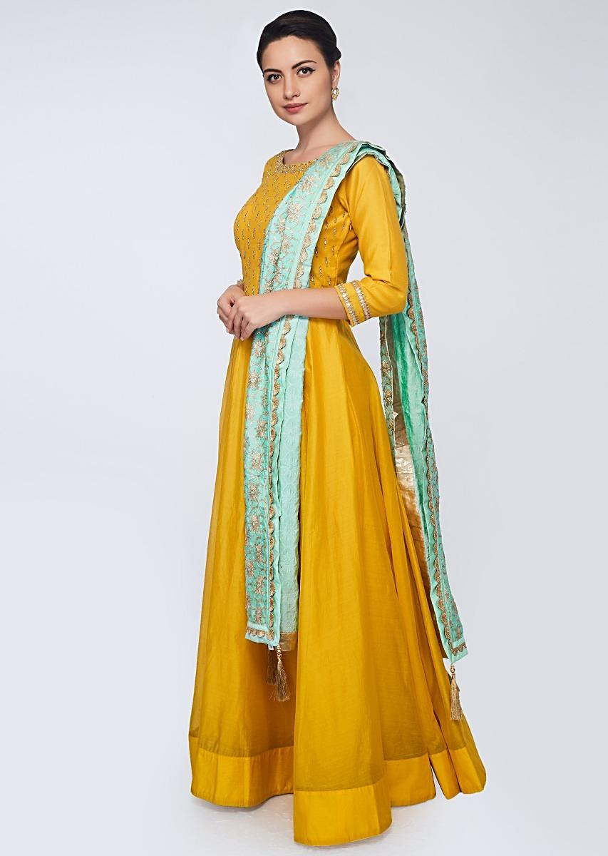 3a6d8d11ec4e Canary yellow silk anarkali gown paired with mint green cotton dupatta in  lace embroidery only on Kalki