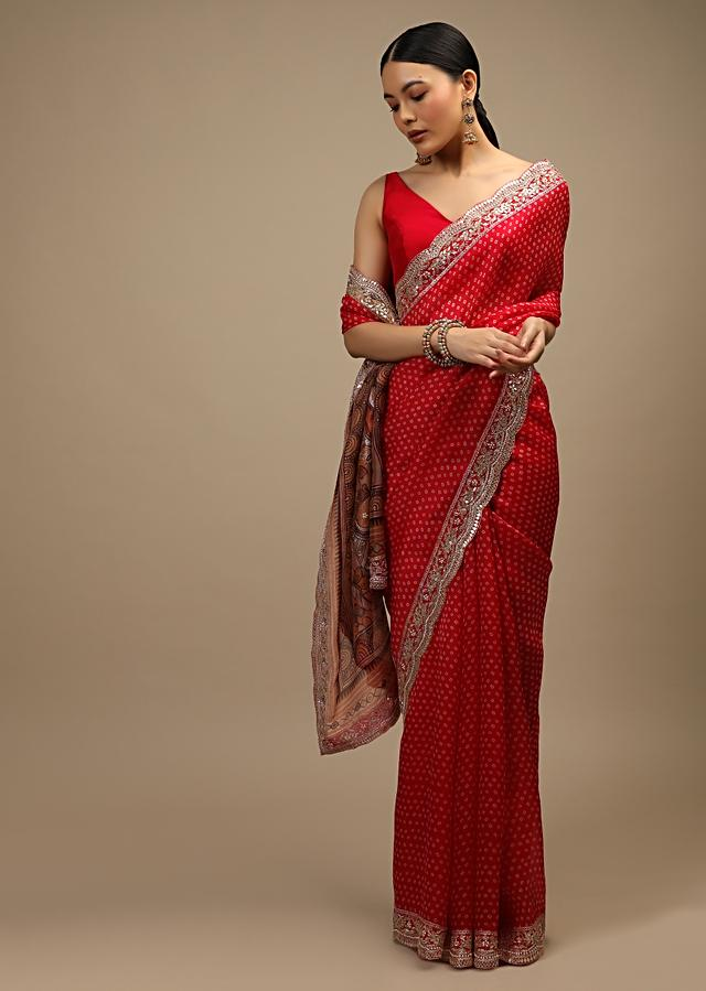 Candy Red Saree In Organza With Bandhani Buttis, Kalamkari Printed Peacock Motifs On The Pallu And Sequins Embroidered Border Online - Kalki Fashion