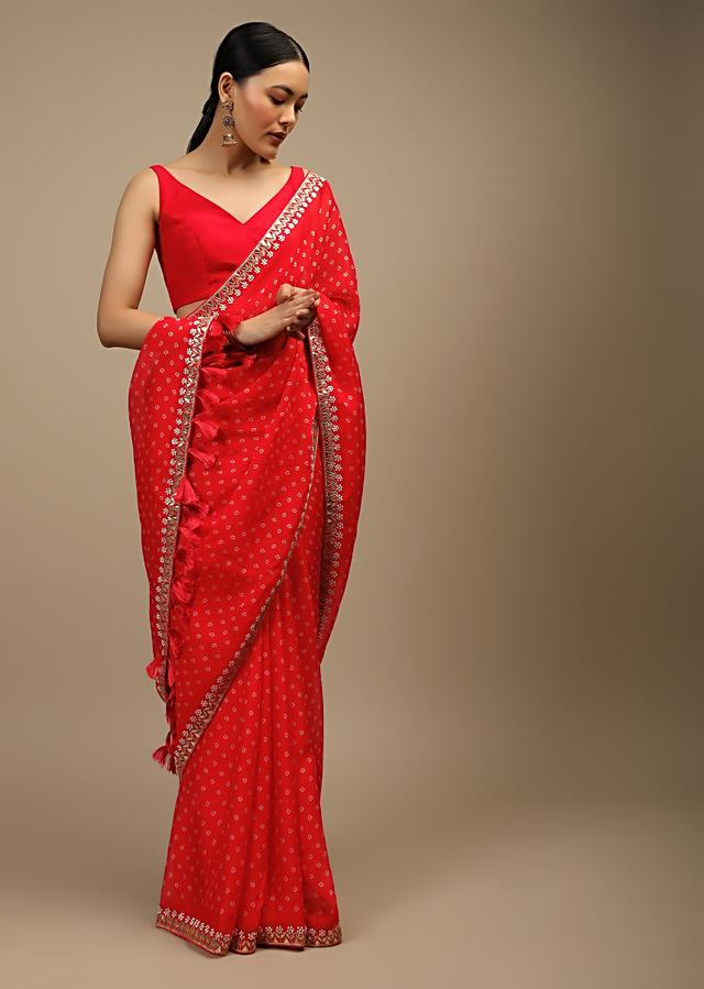 Coral Red Saree In Organza With Bandhani Buttis And Gotta Patti Embroidered Floral Motifs On The Border Online - Kalki Fashion