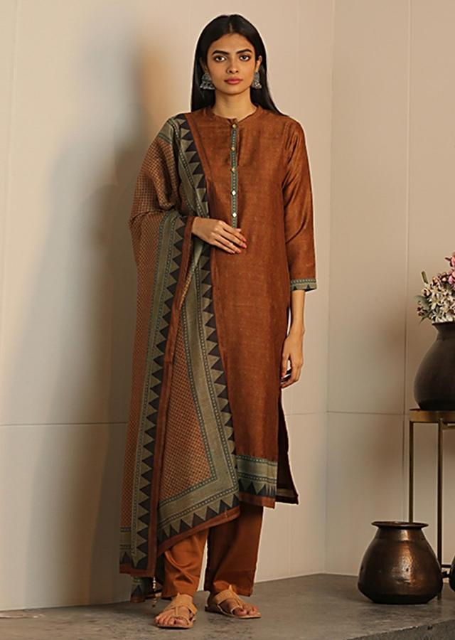 Caramel Brown Unstitched Suit With Matching Dupatta With Tribal Print Online - Kalki Fashion