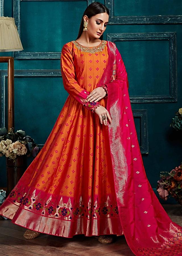 Carrot Orange Anarkali Suit With Weaved Buttis And Patola Motifs On The Hem Online - Kalki Fashion