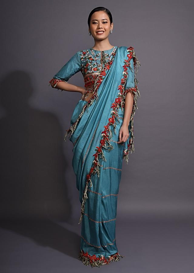 Cerulean Blue Saree With Thread Embroidered Floral Design And Tassels On The Border Online - Kalki Fashion