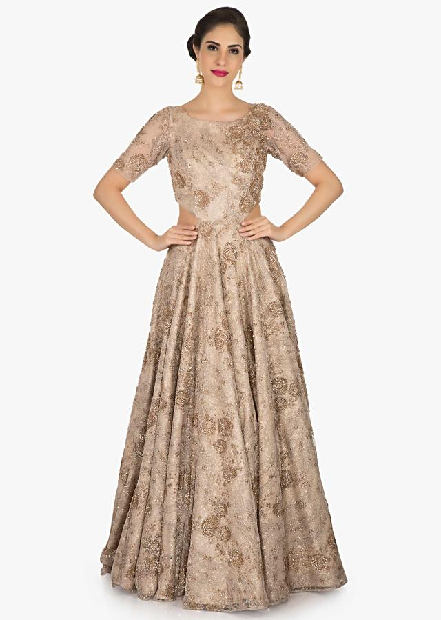Champagne Gold Gown In Net Decorated In Cut Dana And Zari Embroidered Work Online - Kalki Fashion