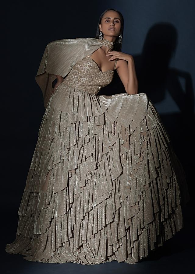 Champagne Gown With Crushed Shimmer Layers And A Fancy One Shoulder Cape Online - Kalki Fashion