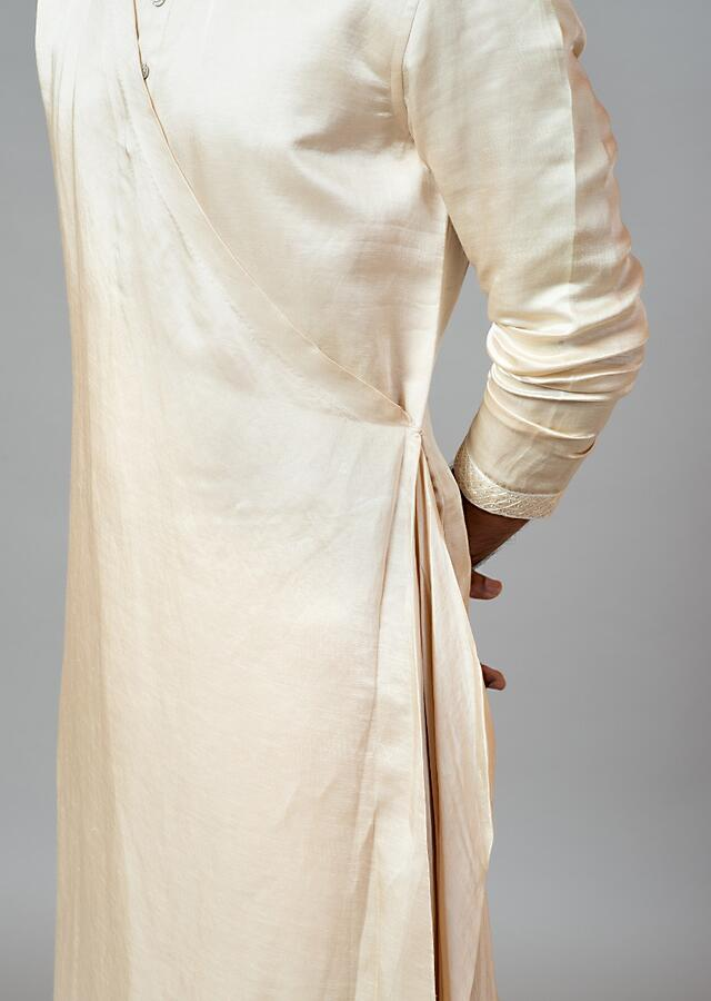 Champagne Kurta Set With Asymmetric Drape And Minimal Embroidery On The Sleeves By Smriti Apparels
