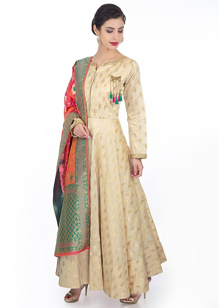 4b4102582 Chanderi silk cream anarkali dress paired with coral brocade dupatta with  teal border only on Kalki