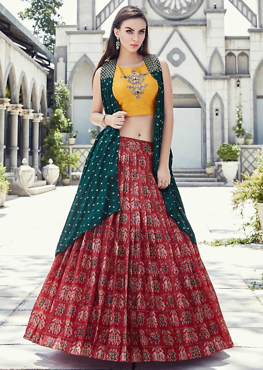 8bc0d084b89 Cherry red lehenga in ikkat motif print matched with yellow crop top blouse  and rama green jacket