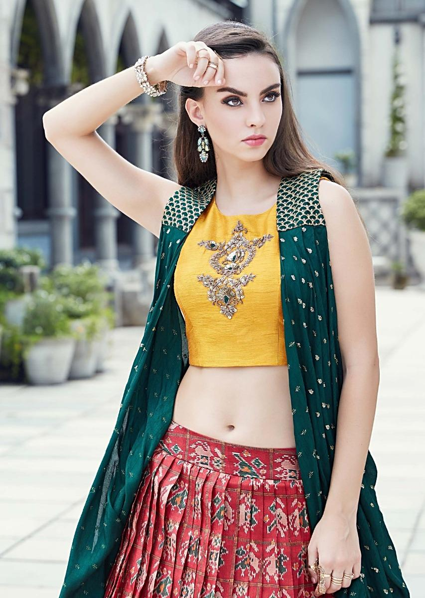 3ac0890baf61a2 Cherry red lehenga in ikkat motif print matched with yellow crop top blouse  and rama green jacket