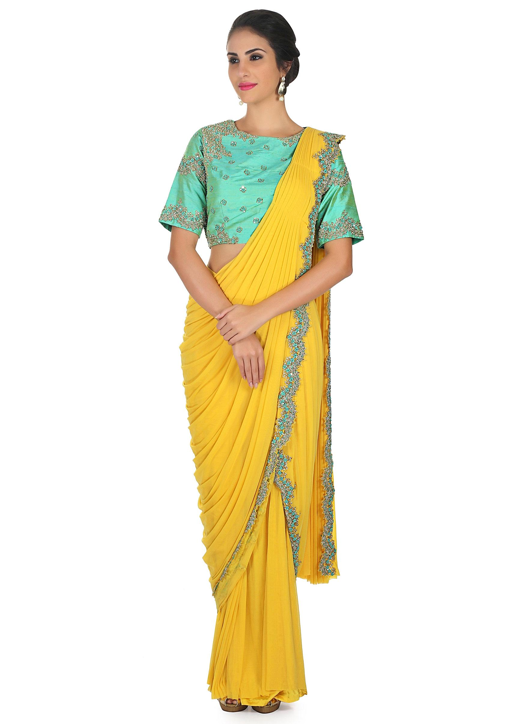 d0cae1520b6a60 Chrome yellow pre stitched saree with turq ready embroidered blouse only on KalkiMore  Detail