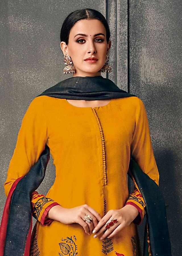 Chrome Yellow Suit With Printed Hem Line And Contrast Jade Green Dupatta Online - Kalki Fashion