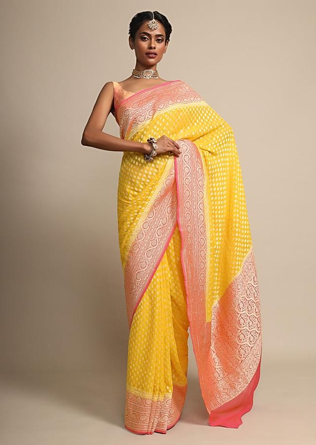 Chrome Yellow Weaved Georgette Saree With Contrasting Fuchsia Pink Border Online - Kalki Fashion