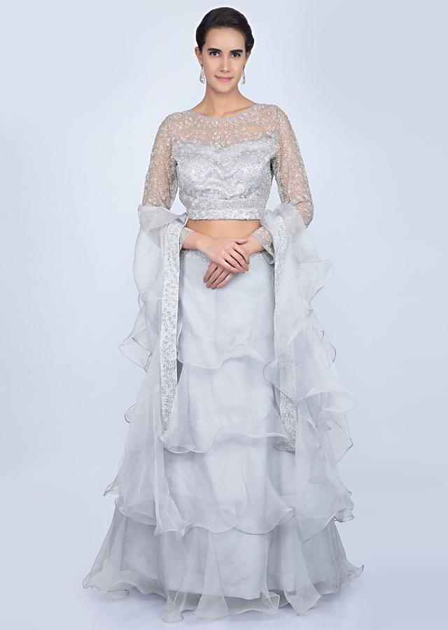 Cloud Grey Blouse In Embroidered Net With Ruffled Lehenga And Dupatta Online - Kalki Fashion