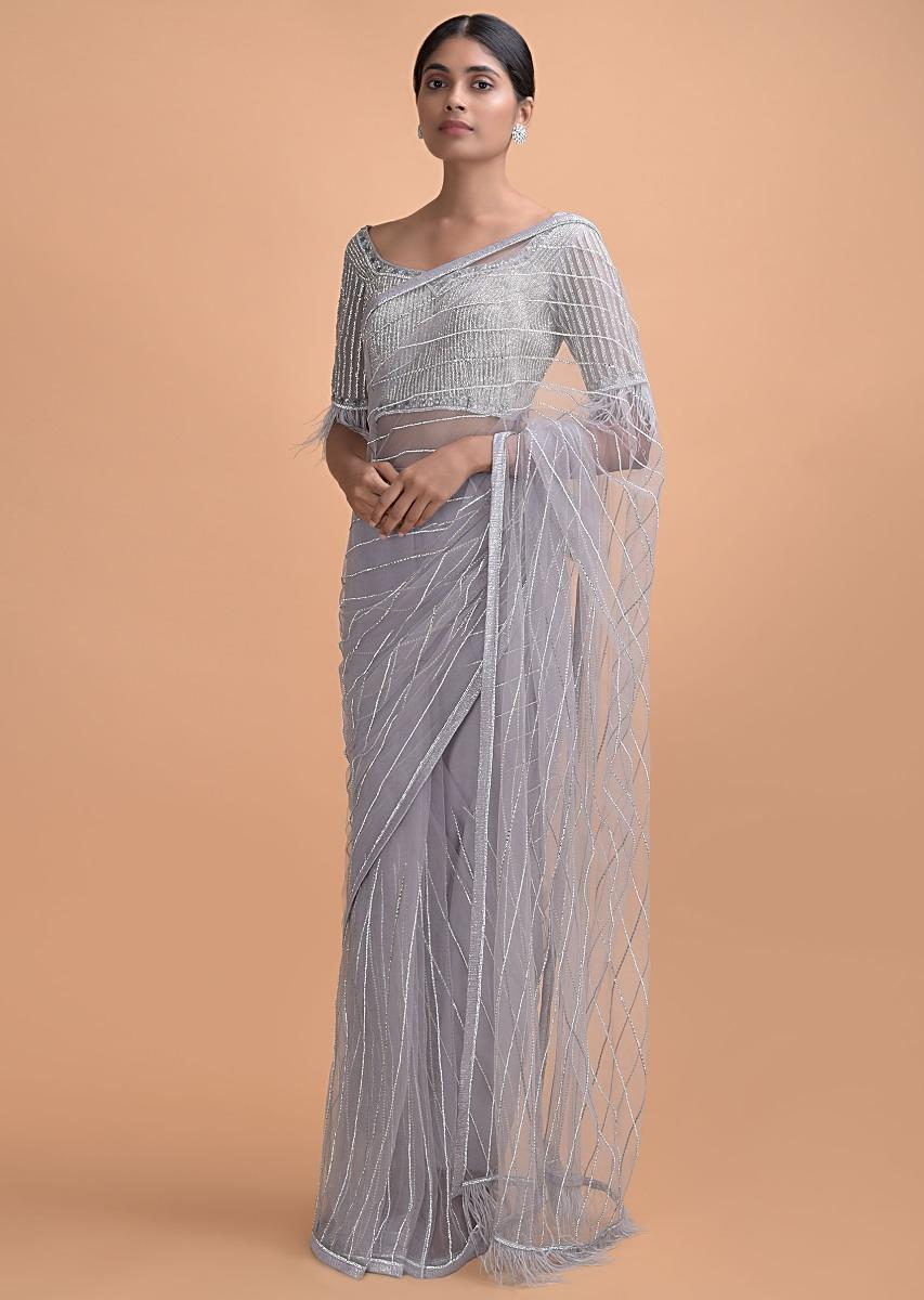 cloud-grey-saree-in-net-with-kundan-work-in-stripes-pattern-and-feathers-on-the-pallu-online-kalki-online-508361_4_.jpg (853×1200)