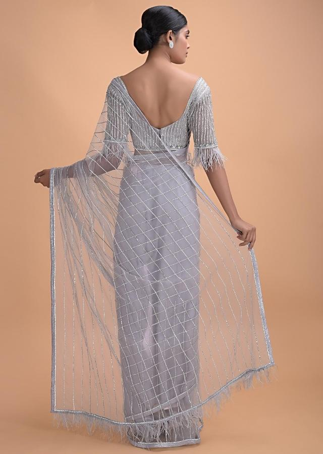 Cloud Grey Saree In Net With Kundan Work In Stripes Pattern And Feathers On The Pallu Online - Kalki Online