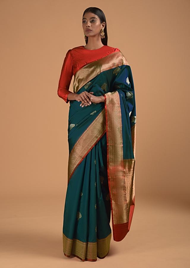 Cobalt Blue Pure Handloom Saree In Silk With Woven Tree Buttis And Red Border Online - Kalki Fashion