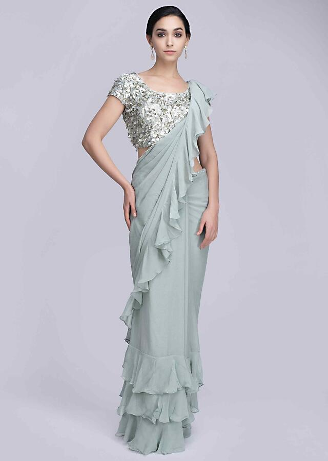 Cobalt green georgette saree with frilled hem and pallo only on Kalki