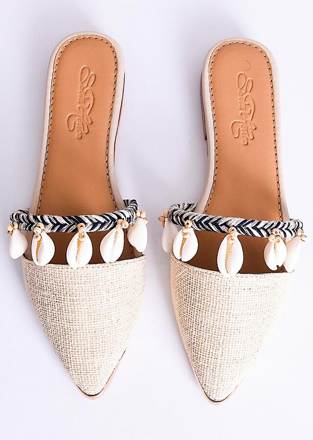 Cream Beige Mules Adorned In Wooden Beads And Conchas Along With Black Braiding By Sole House