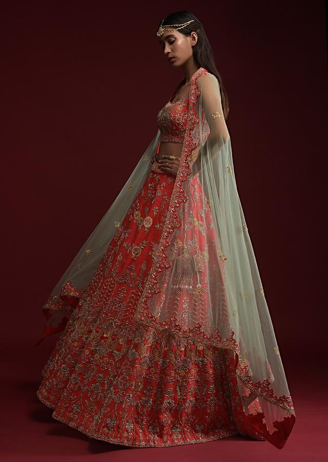 Coral Lehenga Choli In Raw Silk With Hand Embossed Embroidery In Floral And Geometric Motifs Online - Kalki Fashion